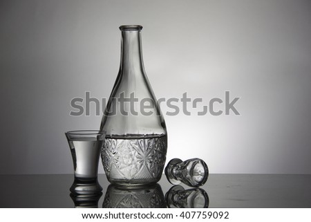 Vodka in crystal decanter, glass of vodka and glass lid