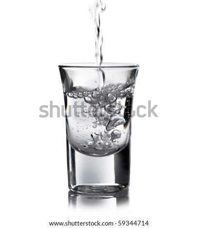 Vodka pouring in a glass - stock photo