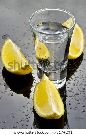 Vodka shot with lemon - stock photo
