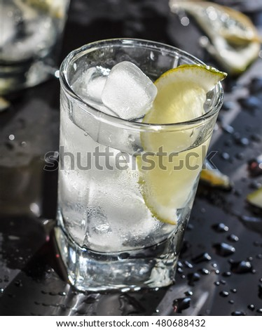 Vodka, Tequila, GIN, vodka in a glass with ice, lime, a cocktail bar, alcohol, alcoholic beverage. Closeup