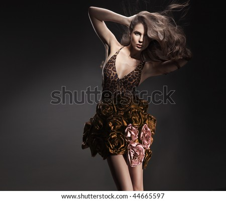 Vogue style photo of a young beauty - stock photo