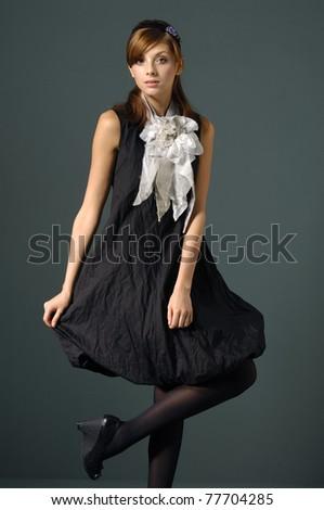 Vogue style photo of fashion model posing in studio - stock photo