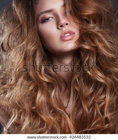 Vogue style photo of sensual woman with long curly hair. - stock photo