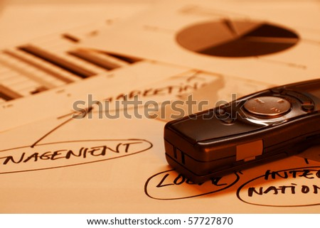 Voice recorder on documents with graphs and project map - stock photo