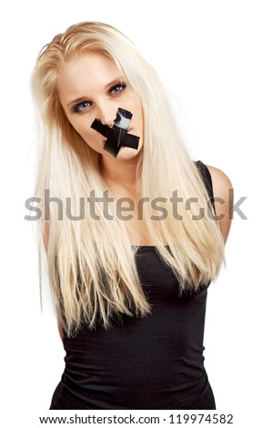 Voiceless woman with a duct tape over her mouth in a struggle for her freedom of expression - stock photo