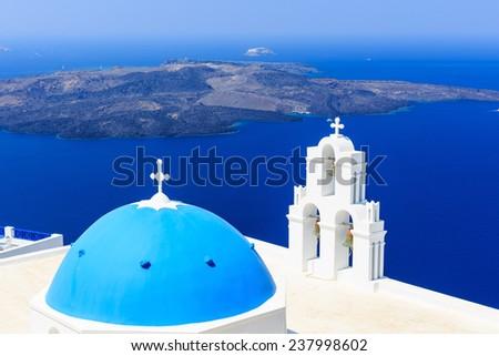 Volcanic caldera and Agios Theodori church (St. Theodore) in Firostefani. Santorini, Greece - stock photo