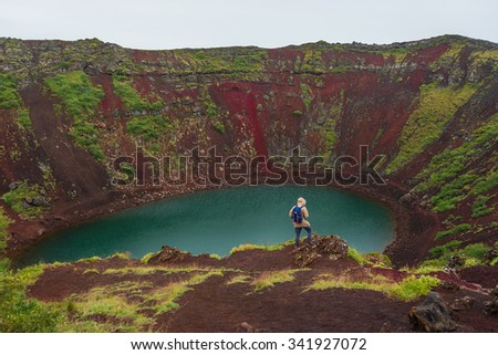 Volcanic crater filled with blue water, Iceland, summer, 2015 - stock photo