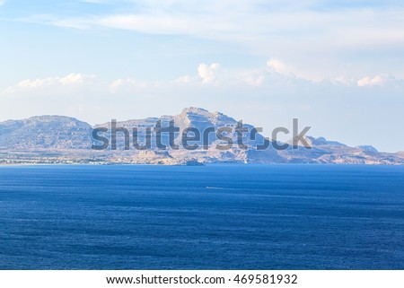 volcanic land in europe Rhodes Greece. Sky, high mountains and mediterranean sea