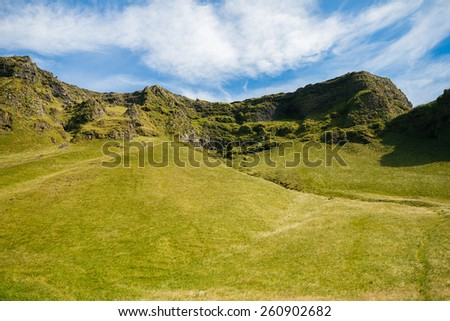 Volcanic landscape covered with moss in Iceland - stock photo