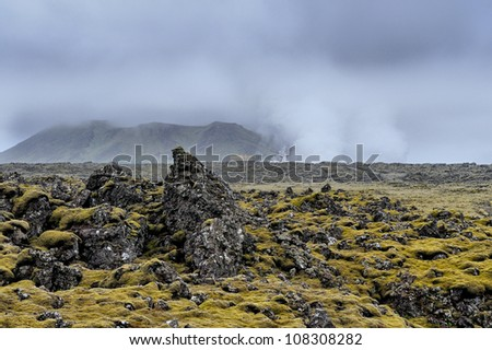 Volcanic landscape on the Reykjanes Peninsula in Iceland near the Blue Lagoon viewed from the road to Grindavik. - stock photo