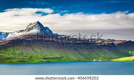 Volcanic mountain over fjord, Iceland - stock photo