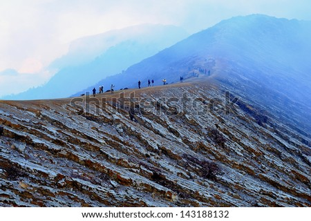 Volcanic Mountain with Smoke from Sulfur - stock photo