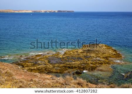 volcanic spain  water coastline  in lanzarote  sky cloud beach  and summer  - stock photo