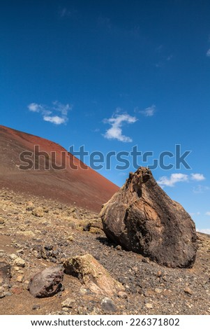 Volcanic stones near Montana Colorada in Lanzarote, Canary Islands, Spain. - stock photo