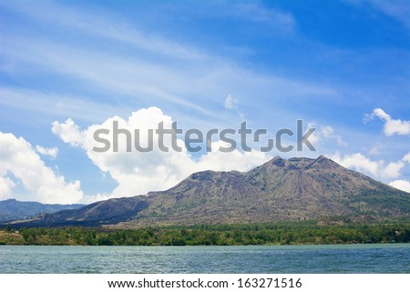 Volcano Batur and Lake Batur Landscape Under Blue Sky in Bali, Indonesia - stock photo