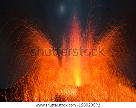 Volcano erupting at night with a very strong eruption - stock photo