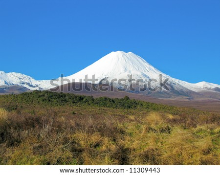 volcano of tongariro covered with snow - stock photo