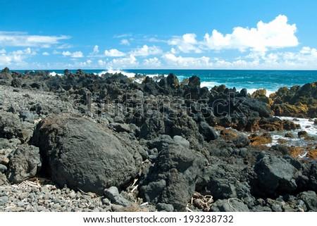 Volcano rocks on beach at Hana on Maui Hawaii - stock photo