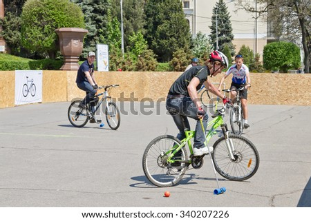 VOLGOGRAD - MAY 4: Young guys playing bike Polo on asphalt upper terrace of the Central embankment. May 4, 2014 in Volgograd, Russia.