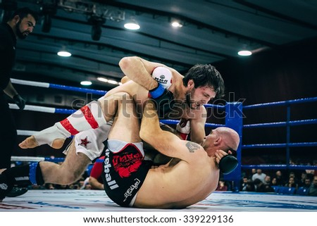 Volgograd, Russia - October 24, 2015: ground fighting is of two athletes of mixed martial arts during Championship of Russia on mixed martial arts - stock photo