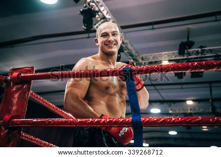 Volgograd, Russia - October 24, 2015: MMA fighter stands in corner and smiled during Championship of Russia on mixed martial arts - stock photo