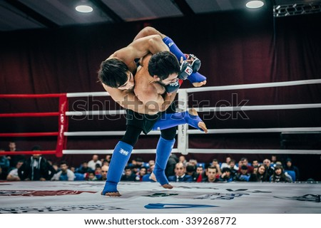 Volgograd, Russia - October 24, 2015: two athletes are fighting MMA in ring during Championship of Russia on mixed martial arts - stock photo