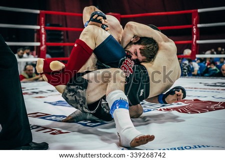 Volgograd, Russia - October 24, 2015: two athletes MMA ground fighting during Championship of Russia on mixed martial arts