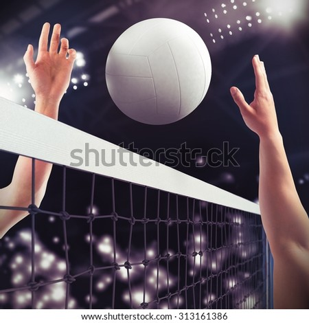 Volleyball ball over the net during match - stock photo