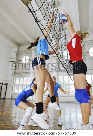 volleyball game sport with group of girls indoor in sport arena - stock photo