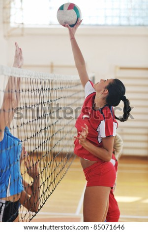 volleyball game sport with group of young beautiful  girls indoor in sport arena - stock photo