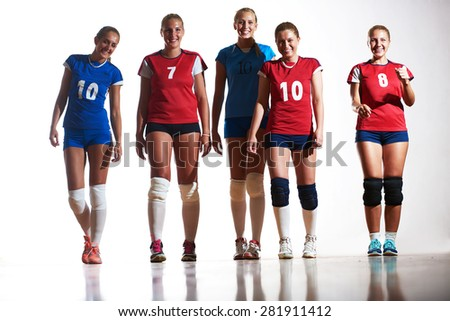 volleyball game sport with group of young beautiful  girls indoor in sport arena ball net - stock photo