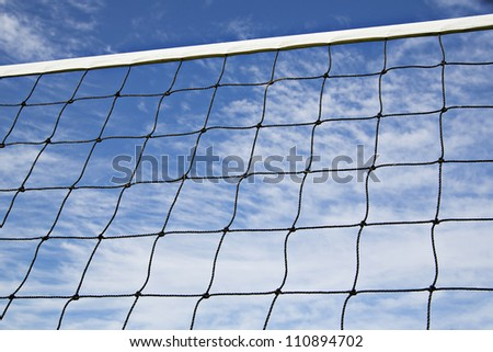 Volleyball net is strained tightly for coming game - stock photo