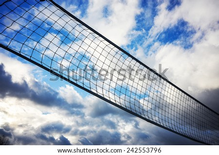 Volleyball net on a blue sky - stock photo