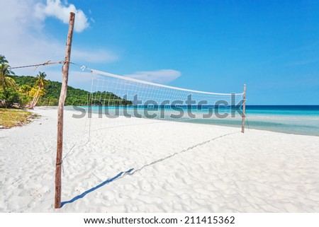 Volleyball net on an empty tropical  beach  - stock photo