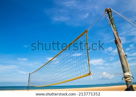 volleyball net on the beach with blue sky - stock photo
