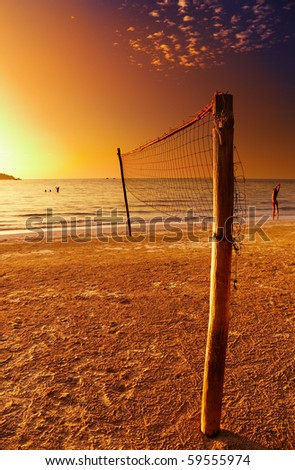 Volleyball net on the tropical beach - stock photo