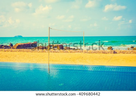 Volleyball net on the tropical beach and sea - Vintage Filter - stock photo