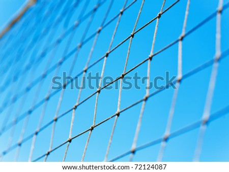 Volleyball net over blue sky - stock photo
