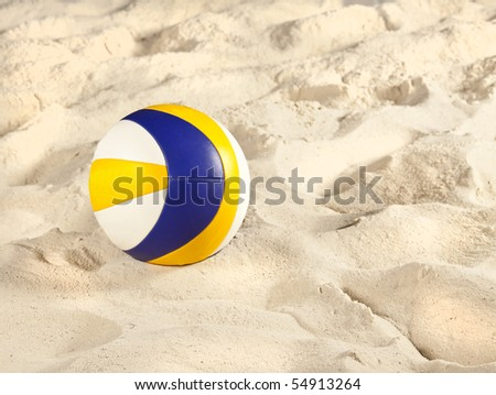 Volleyball on beach volleyball court - stock photo