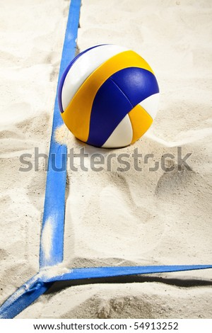 Volleyball on beach volleyball court with lines in view (low angle close up) - stock photo