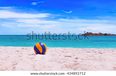 Volleyball on beach with beautiful sea background, Beach ball. - stock photo