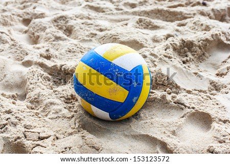 Volleyball on empty beach in twilight - stock photo
