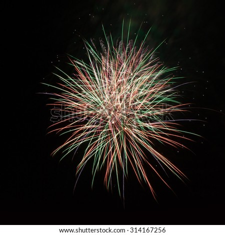 Volleys of fireworks in the night sky - stock photo