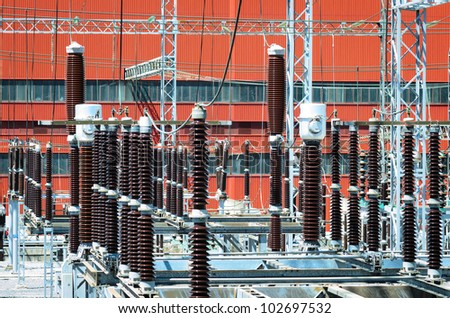 Voltage transformers of hydroelectric power plant. - stock photo
