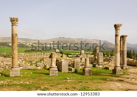 Volubilis is the best preserved Roman site in Morocco, and features some brilliant mosaics. It was declared a UNESCO World Heritage site in 1997. - stock photo