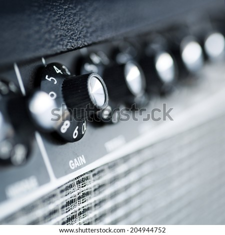 volume button guitar amplifier  closeup - stock photo