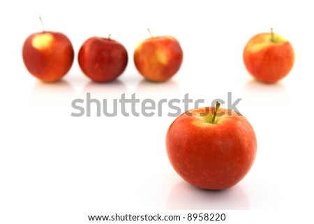 Volunteer concept. Apple standing out in a row of red apples. - stock photo