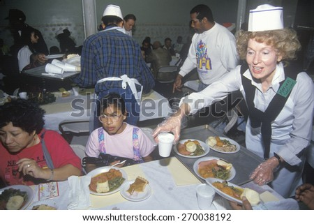Volunteers serving Christmas dinner for the homeless, Los Angeles, California - stock photo