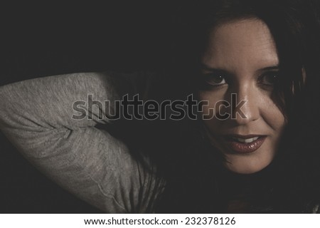 voluptuous, beautiful young brunette with sexy appearance, wearing a thin sweater gray - stock photo
