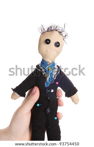 Voodoo doll boy-groom in the hands of women isolated on white - stock photo